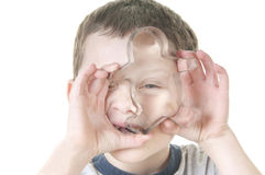 Young boy with cookie cutter Stock Photos