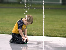 Young Boy Cooling Off Stock Photo