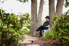 Young boy in costume. A young boy wearing a costume with a mustache Royalty Free Stock Photo