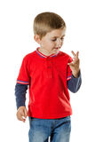 Young boy counting fingers Royalty Free Stock Photography