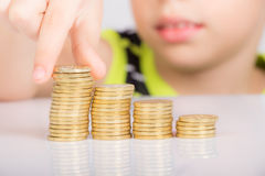Young boy counting his coins stock images