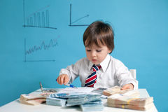 Young boy, counting money, taking notes. Young boy, counting money and taking notes Royalty Free Stock Photo
