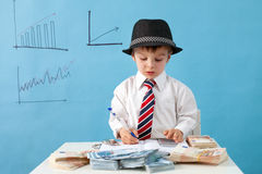Young boy, counting money and taking notes Stock Image