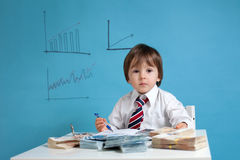 Young boy, counting money and taking notes. Isolated Stock Image