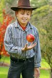 Young Boy in Country with Red Apple royalty free stock photo