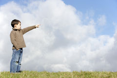 Young Boy In Countryside Pointing Royalty Free Stock Photos