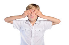 Young boy cover eyes Stock Photos