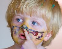 Young boy covered in face paint Royalty Free Stock Images