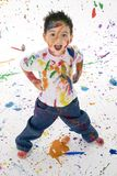 Young Boy Covered in Paint Splatter stock image