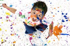 Young Boy Covered in Paint Splatter stock photos