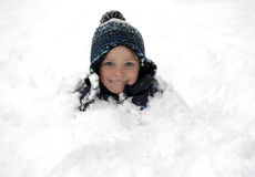 Young boy covered with snow. Young and cute smiling boy covered with snow Stock Image