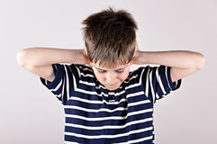 Young boy covering his ears with hands Stock Photography