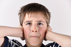 Young boy covering his ears with hands Stock Images
