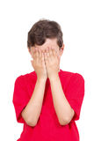Young boy covering his eyes stock photo