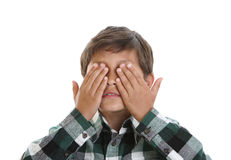 Young boy covers his eyes Royalty Free Stock Photography