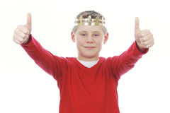 Young boy with crown giving you thumbs up Stock Photo