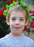 Young boy with a crown of leaves Royalty Free Stock Image