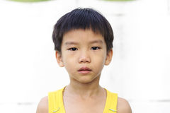Young boy cry and tear. In front of concrete wall Stock Photos