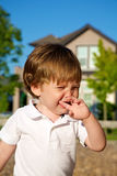 A young boy crying at the park Stock Images