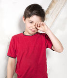 Young boy crying. Young boy in red t-shirt is crying Royalty Free Stock Photo