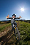 Young boy cycling Stock Photos