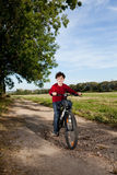 Young boy cycling Stock Photography