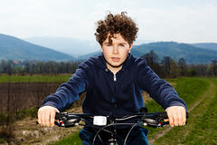 Young boy cycling Royalty Free Stock Photography