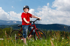 Young boy cycling Royalty Free Stock Image