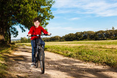 Young boy cycling Royalty Free Stock Photos