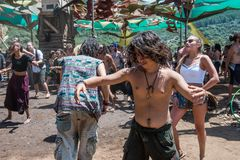 A young boy dances uninhibited on the main stage of the Lost Theory psytransce music festival held in Riomalo de Abajo