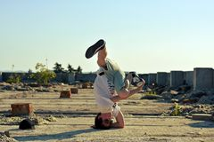 Young boy dancing break dance on the street Royalty Free Stock Image