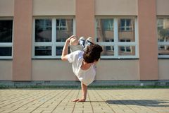 Young boy dancing break dance on the street Royalty Free Stock Photos