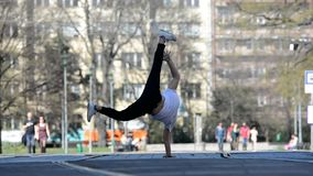 Young boy dancing breakdance in the city. stock footage