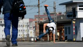 Young boy dancing breakdance in the city. stock video footage