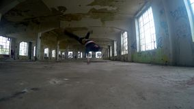 Young boy dancing breakdance in the old hall, 4K stock video