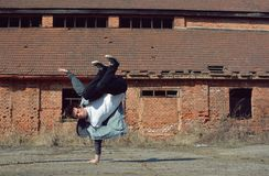 Young boy dancing breakdance on the street Royalty Free Stock Images