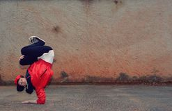 Young boy dancing breakdance on the street Royalty Free Stock Image
