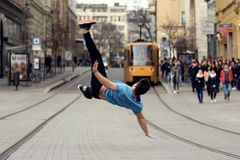 A young boy dancing breakdance on the street. Stock Photos