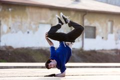A young boy dancing breakdance on the street. Stock Images