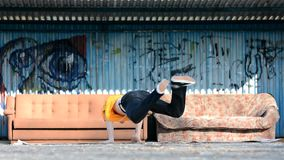 Young boy dancing breakdance on the street. stock video