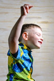 Young Boy Dancing and Snapping Fingers Stock Images