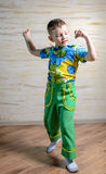 Young Boy Dancing and Snapping Fingers Royalty Free Stock Photography