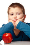 Young Boy deciding to eat an apple Stock Images