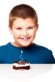 Young boy deciding to eat a dessert Royalty Free Stock Photos