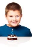 Young boy deciding to eat a dessert Royalty Free Stock Photos