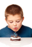 Young boy deciding to eat a dessert Royalty Free Stock Images