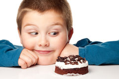 Young boy deciding to eat a dessert Stock Photos