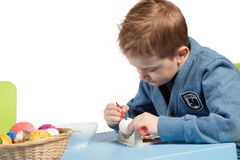 Young boy decorating Easter eggs Stock Image