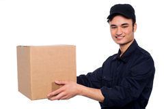 Young boy delivering parcel Royalty Free Stock Photography