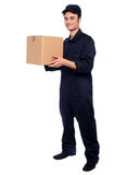 Young boy delivering parcel Stock Photos